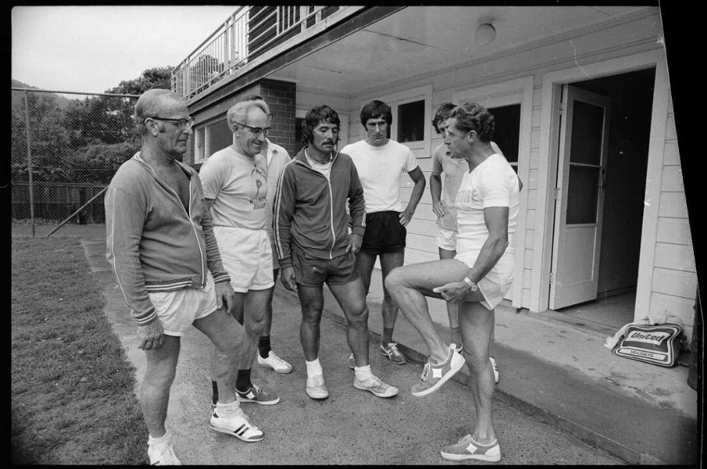 Athletics coach Arthur Lydiard provides advice to joggers in Anderson Park, Wellington. Photograph taken 17 February 1975 by an unidentified Evening Post staff photographer.